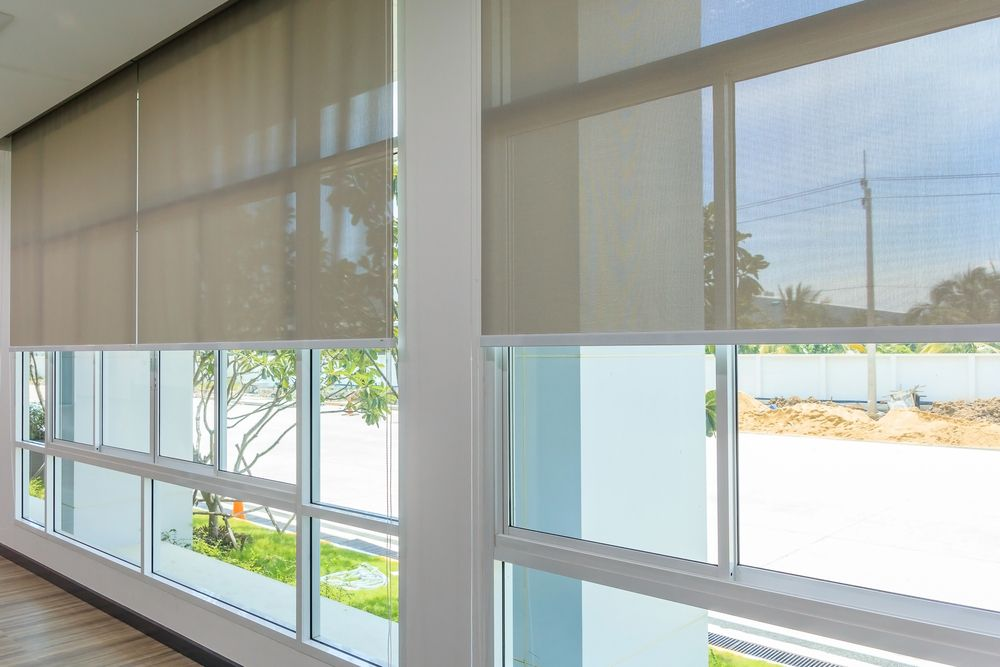 Roll Blinds on the windows, the sun does not penetrate the house. Window in the Interior Roller Blinds