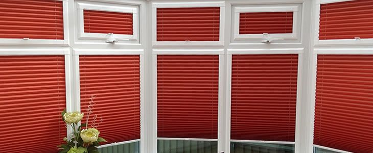 perfect fit blinds in red on conservatory windows