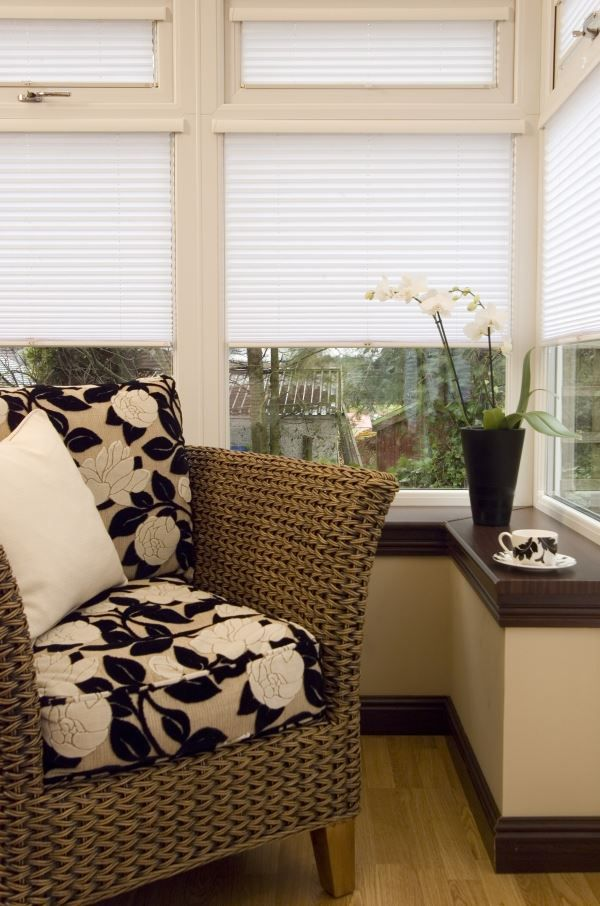 white blinds in conservatory with pleated seat