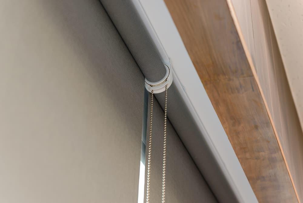 grey roller blinds close up